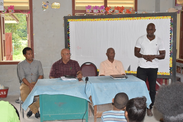 ( head table from left to right) Mr. Dexter Harding - Coomacka CDC Chairman, GWI's Managing Director - Dr. Richard Van West-Charles, Mr. Eugene Gilbert - Director of the National Community Development Council & Mr. Dwayne Shako - GWI's Executive Director of Operations