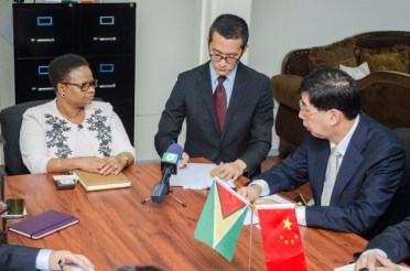 [In the photo, from left to right] Minister of Public Health, Hon. Volda Lawrence; Interpreter, Tao Wong; Inspector of Foreign Affairs of Jiangsu Province, Xiqiang Huang.