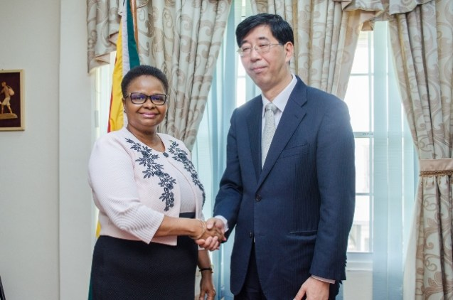 [In the photo, from left to right] Minister of Public Health, Hon. Volda Lawrence and Inspector of Foreign Affairs of Jiangsu Province, Xiqiang Huang.