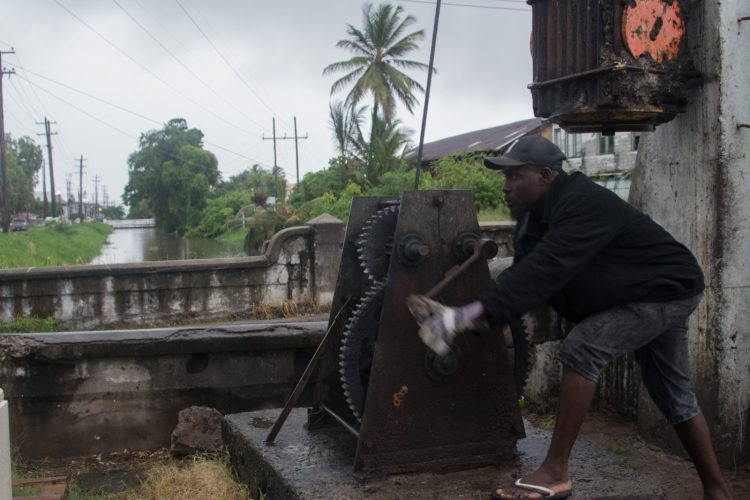 Worker about to open the Water Street Koker