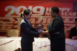Minister of Public Health Volda Lawrence presents one of the doctors of the 14 Chinese Medical Brigade with a token of appreciation