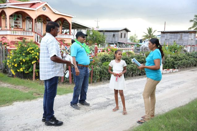 Minister of Indigenous Peoples' Affairs, Sydney Allicock engaging a resident of Cove and John during a walkabout.