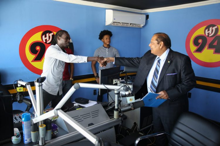Prime Minister, Hon. Moses Nagamootoo greeted by Radio Host, Stan Gouveia of 94.1Boom FM's 'Hot Seat'