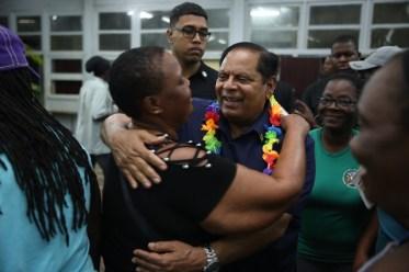 Prime Minister, Hon. Moses Nagamootoo greets a resident.