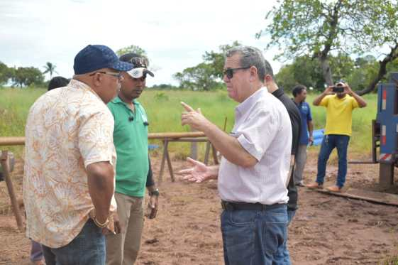 GWI officials in conversation with contractor, Mr. Franklin, whose company drilled the well in Moco Moco