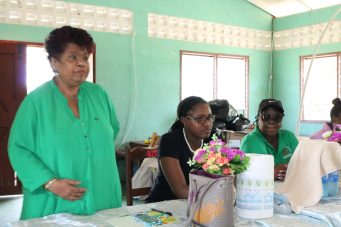 Minister of Social Protection, Hon. Amna Ally addressing the residents of Liberty, lower Pomeroon at a community meeting