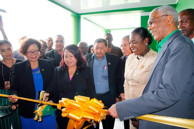 The ceremonial cutting of the ribbon to officially open the new dormitory
