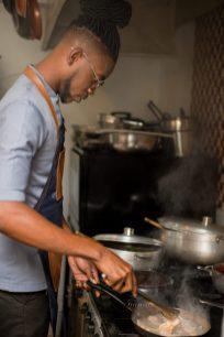 Chef Kester Robinson preparing a meal