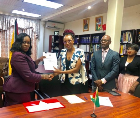 Collette Adams, Permanent Secretary, Ministry of Public Health and Avia Lindie, Representative of Alpha & Omega Community Developers Inc after the signing of the grant agreement.