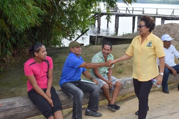 Minister Garrido-Lowe meets residents of Orealla.