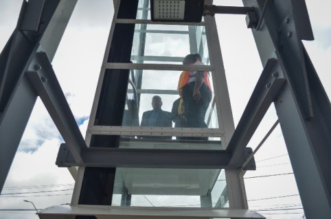 Minister of Public Infrastructure, Hon. David Patterson along with Minister within the Ministry of Public Infrastructure, Hon. Jaipaul Sharma takes test ride on elevator at Peter's Hall overpass.