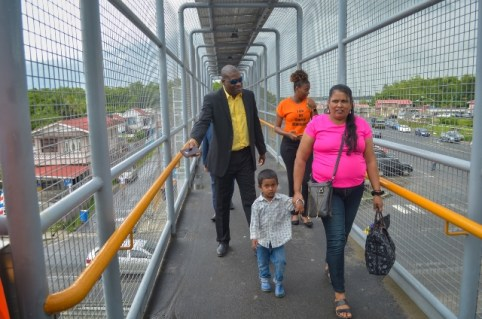 Minister of Public Infrastructure, Hon. David Patterson guides commuters on the Peter's Hall overpass.