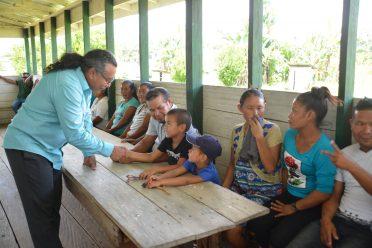 Member of Parliament, Hon. Mervyn Williams greets residents of Kako Village, in Region 7