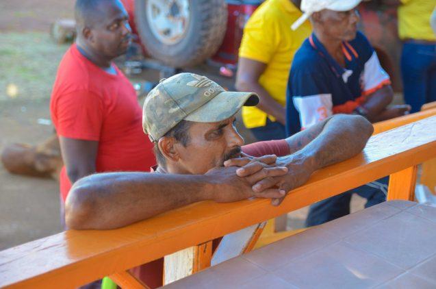 Miners listening attentively to Ministers Hon. Raphael Trotman and Hon. Ronald Bulkan at a public meeting at Kanawaruk Tumatumari Junction, Region 8