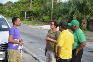 Minister within the Ministry of Indigenous Peoples' Affairs. Hon. Valerie Garrido-Lowe interacts with some of the Yarrowkabra residents in a walkabout before the community meeting.