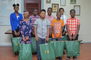 Eight of the 14 beneficiaries who were present to receive he tokens from the Minister of Public Health on behalf of the ministry.