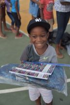One of the children after receiving his school suppliesed his gifts.