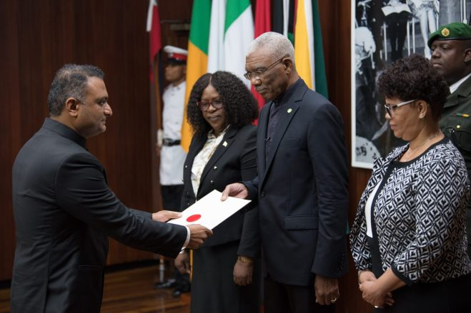 India's High Commissioner to Guyana, His Excellency Dr. K. J. Srinivasa, presents his letter of credence to His Excellency, President David Granger in the presence of Minister of Foreign Affairs, Hon. Dr. Karen Cummings and Director-General of the Ministry of Foreign Affairs, Audrey Waddell.