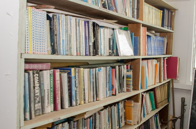 Well stocked bookshelf in the library in GRECO Training Center in Victoria, East Coast of Demerara.