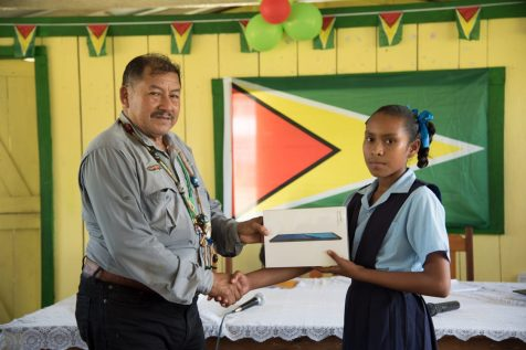 Ginessa Gomez of Paruima Village receives her tablet from Minister of Indigenous Peoples' Affairs, Hon. Sydney Allicock