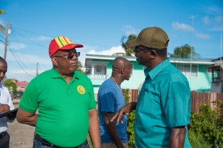 Minister of Finance, Hon. Winston Jordan in discussion with a resident of Fyrish West Berbice, during a walkabout in the community.