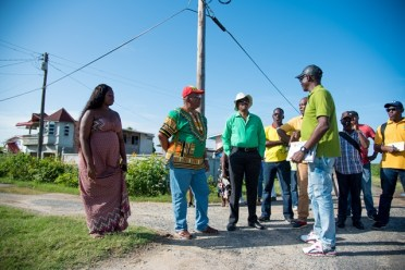 Minister of Finance, Hon. Winston Jordan and Minister of Legal Affairs, Hon. Basil Williams SC meeting several Litchfield residents during a walkabout of the community.