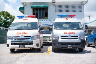 The two ambulances which have been handed over to the two regions.