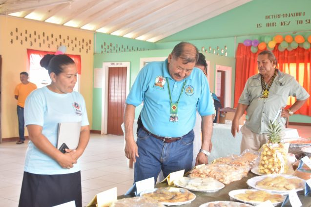 Minister of Indigenous Peoples' Affairs, Hon. Sydney Allicock viewing some of the food items prepared by members of the Parishara Organic Food Processors, on display