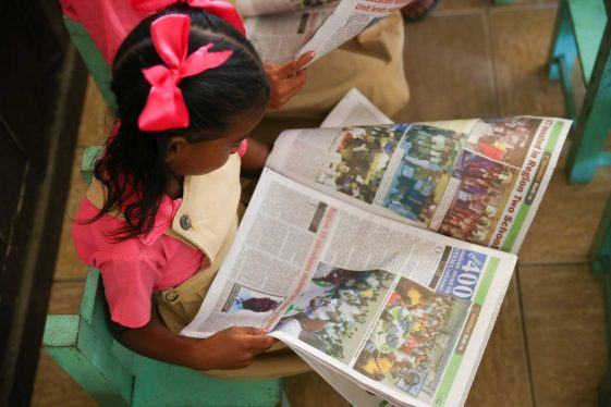 A student of the El Paso Primary browsing the Hinterland Highlights publication