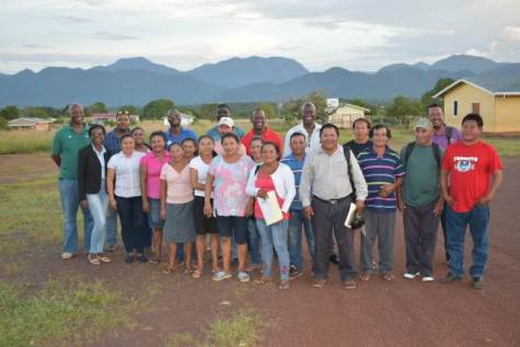 Facilitators of the WASH Programme pose with participants after their training session in Nappi Village, Region 9.