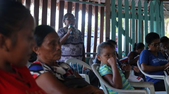 Some of the residents who gathered at the community meeting held at Princeville, Region 8