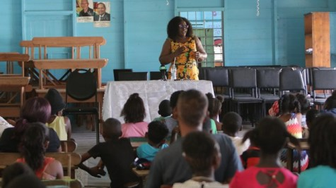 Minister of Foreign Affairs, Hon. Karen Cummings speak to residents at a community meeting at Rosignol