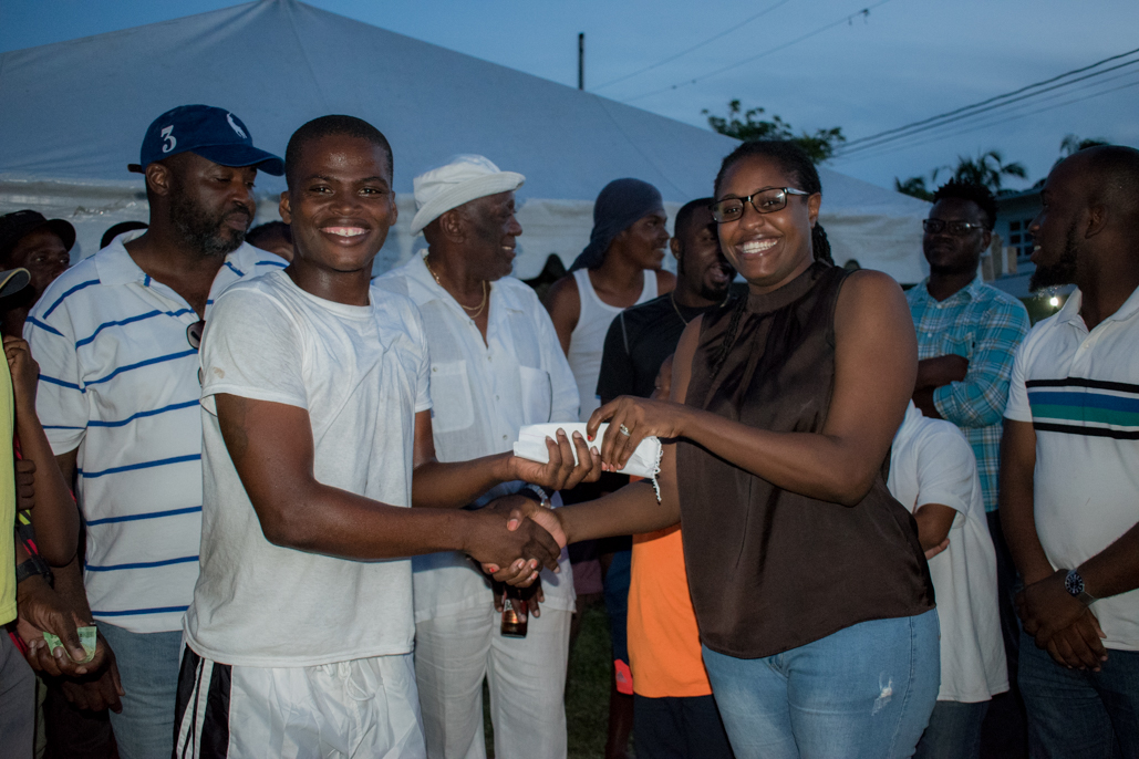 Public Service Minister, Hon. Tabitha Sarabo-Halley hands over first place cash price to the team captain