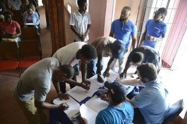 Lindeners sign up application forms to join Schlumberger Guyana