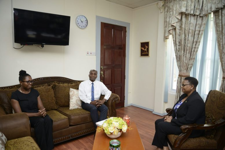 Minister of Public Health, Hon. Volda Lawrence meets with Child and Adolescent Psychiatrist, Dr. Jenese October along with Director of Pharmacies, O'neil Atkins
