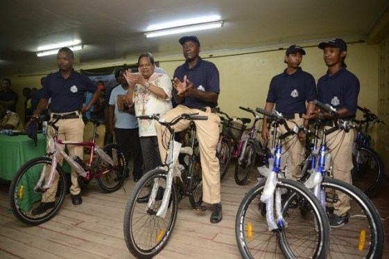 Prime Minister, Hon. Moses Nagamootooo hands over the bicycles to members of the CPG.