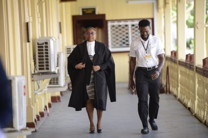 Chief Justice (ag), Roxane George on her way to the courtroom