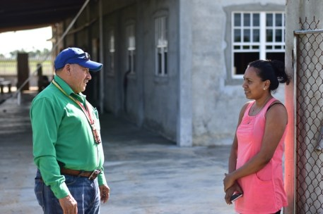 Minister of Indigenous Peoples' Affairs, Sydney Allicock speaks with Foulis Resident Subrina Ramoop on a walkabout the village.