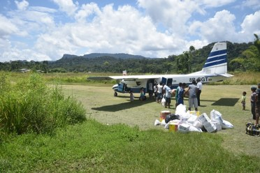 Plane taking food packages to Region 7 communities of Purima and Kurukubaru.