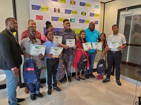 President of Caribbean Nations Group (CNG) Jevaughn Stephen along with the scholarship awardees and the Deputy-Mayor of New Amsterdam Wainwright McIntosh