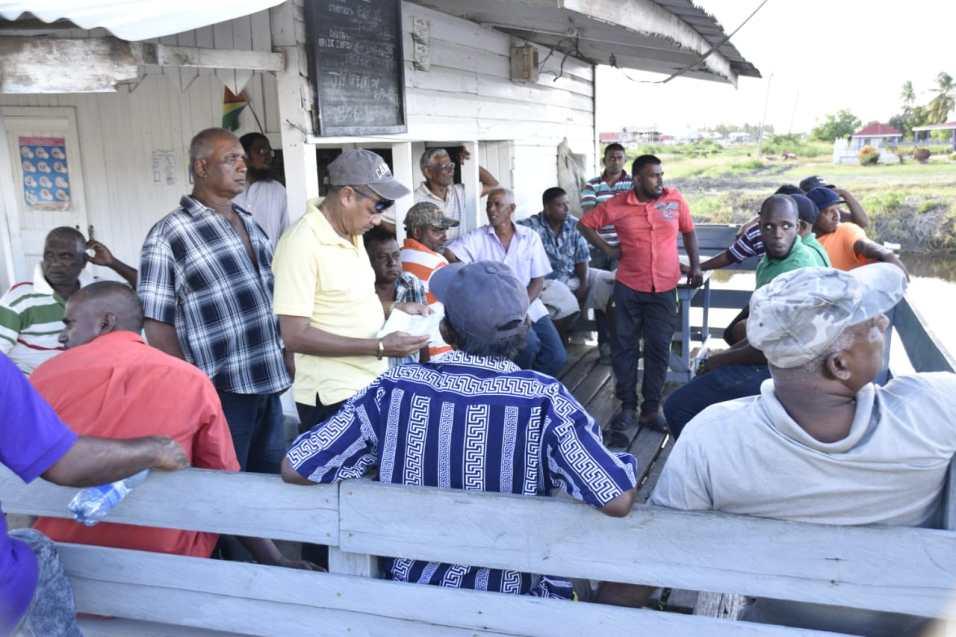 Close knit community meeting in Yakusari Village