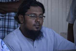Resident of Yakusari engaging Minister of Business Honourable Haimraj Rajkumar