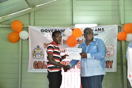BIT Board Chairman, Clinton Williams hands over a certificate of completion to one of the participants