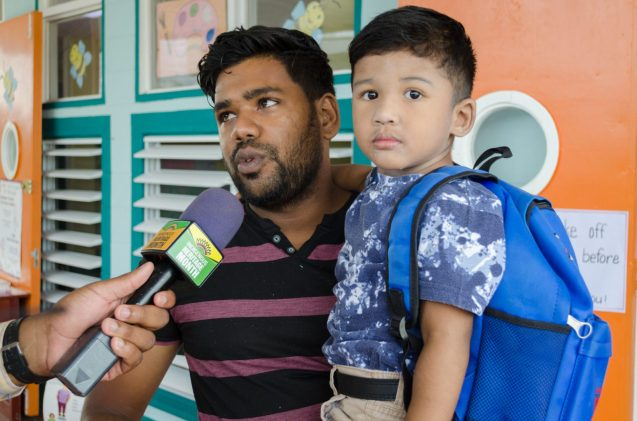 Ameer Haniff and his son Jaden all ready for school.