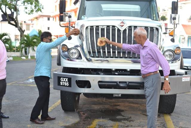 Minister of Communities, Hon. Ronald Bulkan and His Worship the Mayor of Georgetown, Pandit Ubraj Narine blessed the new machine.