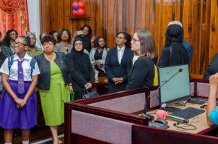 Minister Ally with members of the Judiciary and special invitees during a tour of the new court.