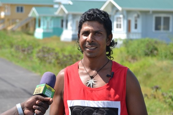 Beekram Khublall, a satisfied resident of Experiment Housing Scheme, West Coast of Berbice (WCB).