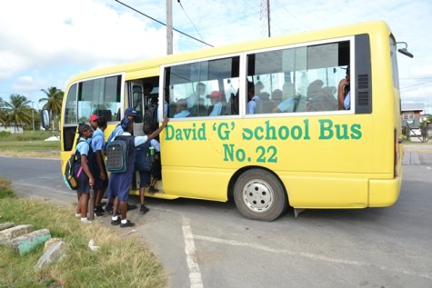 Students eagerly board the David 'G' Bus, that Frederick Stuart drives.