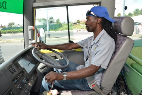 A bus driver of the David 'G' Bus, Frederick Stuart, hard at work carrying the nation's future.