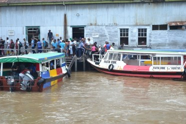 Commuters boarding the speed boats to get to work and school.